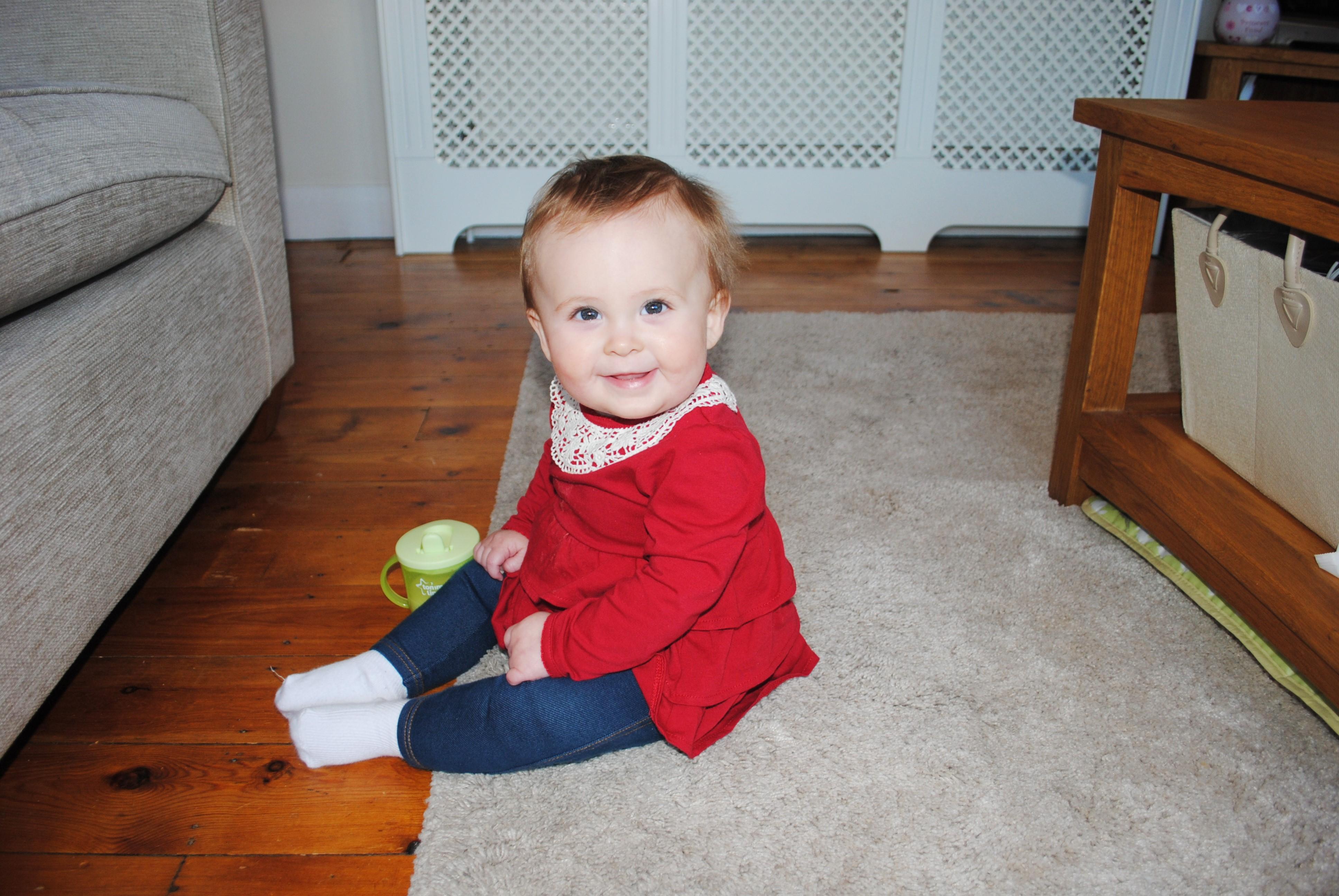 eva drinking milk at home 10 months old