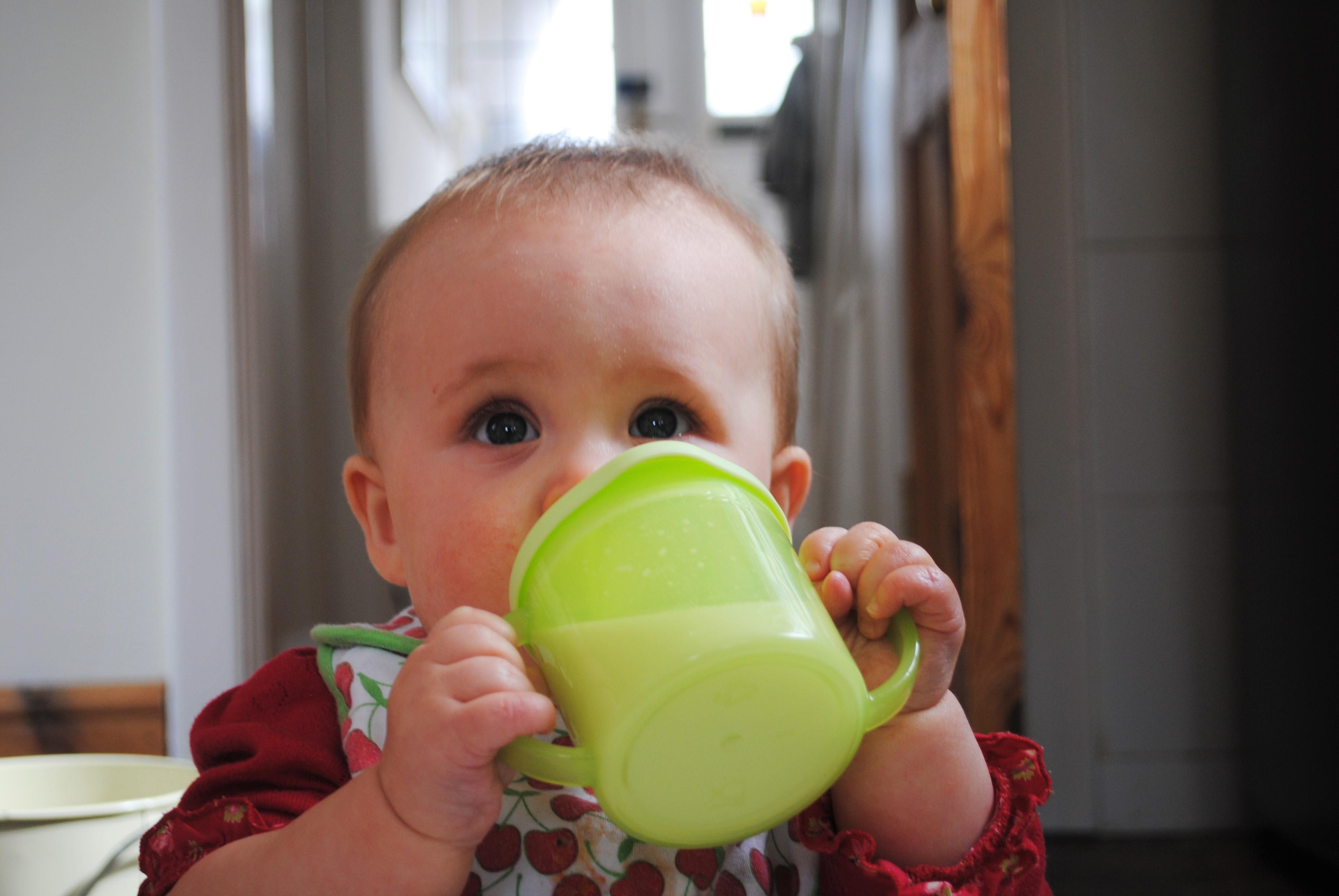 Eva drinking milk at 6 months old