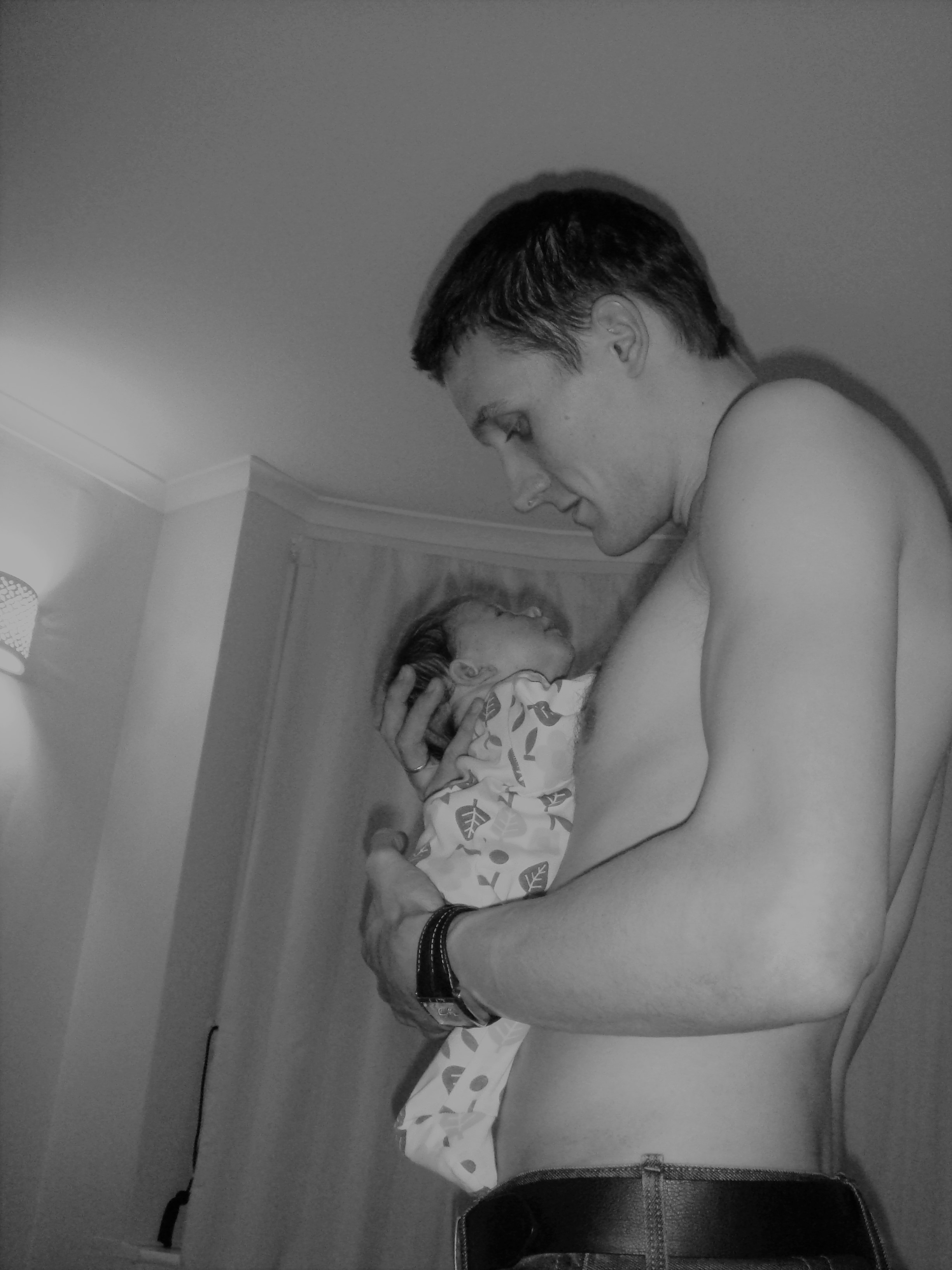 Becoming Dad Paternity leave holding newborn on chest skin to skin