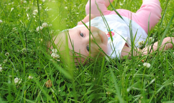baby hair loss my little bald baby in the grass